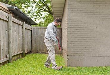 pest tech applying pest control treatment
